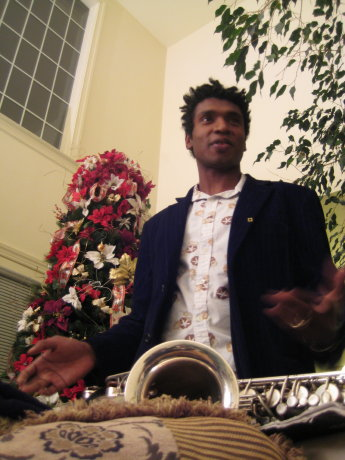 Stephon Alexander with saxophone