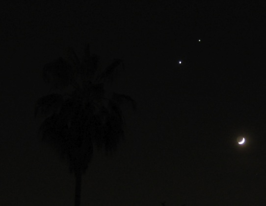 conjunction of jupiter (top), venus (middle) and the waxing crescent moon (er, bottom)