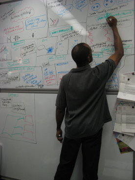 clifford johnson preparing slides at the board